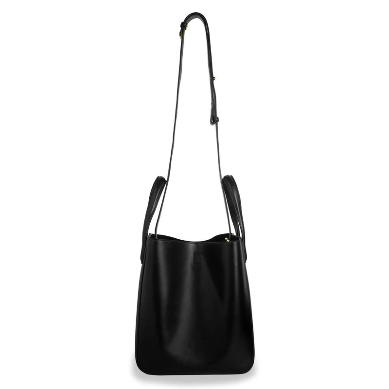 X NIHILO Eight in black bag, fashion bag with adjustable shoulder strap, single snap button top closure, and soft gold hardware, luxury cow nappa leather handbag, genuine leather bag
