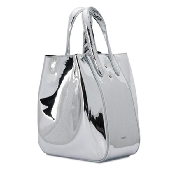 X NIHILO Eight in metallic silver vegan leather, fashion bag with adjustable shoulder strap, single snap button top closure, and silver hardware, PETA approved, silver mirror vegan leather bag