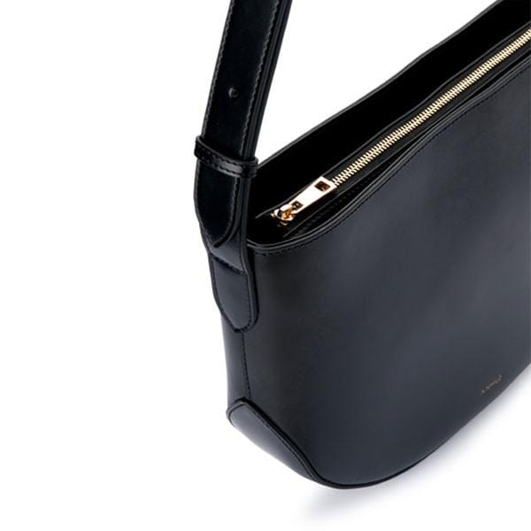 X NIHILO Hustler crossbody bag in black, fashion bag with soft gold hardware, zip closure, and adjustable strap, luxury black box leather handbag, genuine leather bag