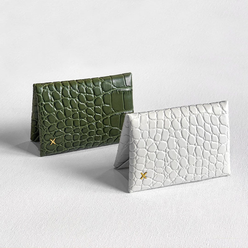 Olive croc print leather cardholder and white croc print leather cardholder placed adjacent to each other against a white background.