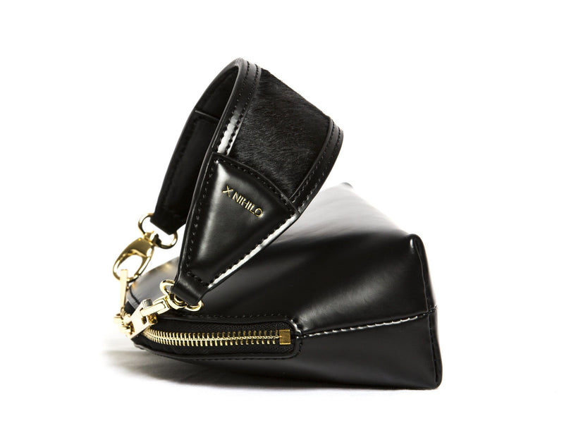 X NIHILO Stella in black with soft gold hardware, fashion bag with zip top closure and removable handle, luxury black box leather with pony hair (cowhide) handbag, genuine leather bag