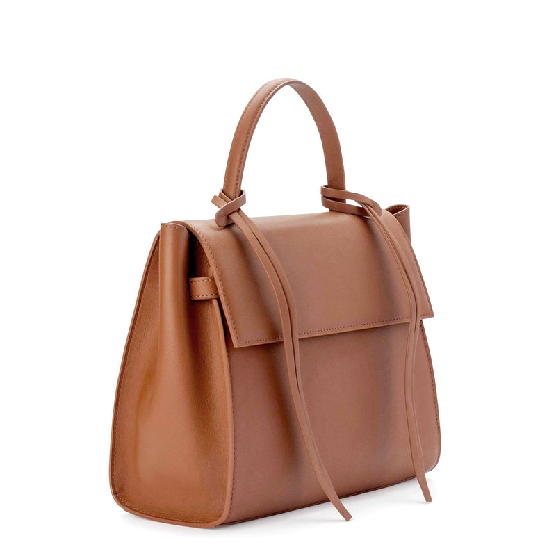 Angled side view of rectangle genuine tan leather work bag and handbag with leather tassels, front flap and handle.