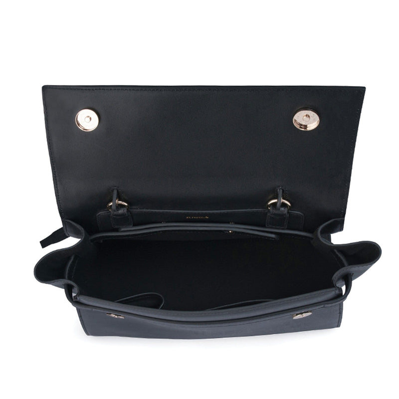 Top view of opened rectangle black leather bag, two metal fasteners attached on either sides of the opened flap.