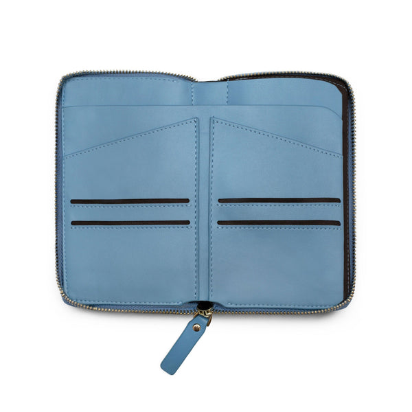 View of opened sky blue leather wallet and passport holder with four cardholder slots and two slots for passports.