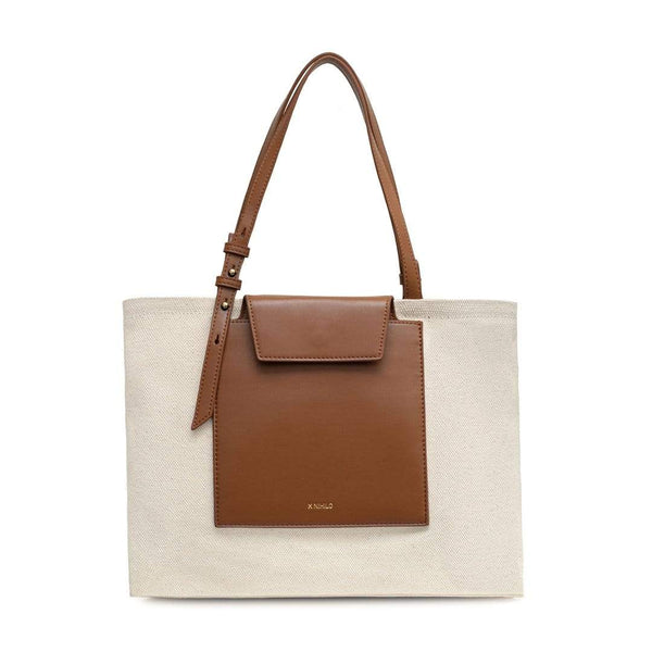 Rectangle tan leather and natural canvas fabric tote bag with tan leather handle, logo X NIHILO embossed small on the surface.