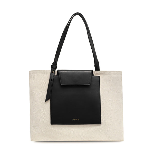 Rectangle black leather and natural canvas fabric tote bag with black leather handle, logo X NIHILO embossed small on the surface.
