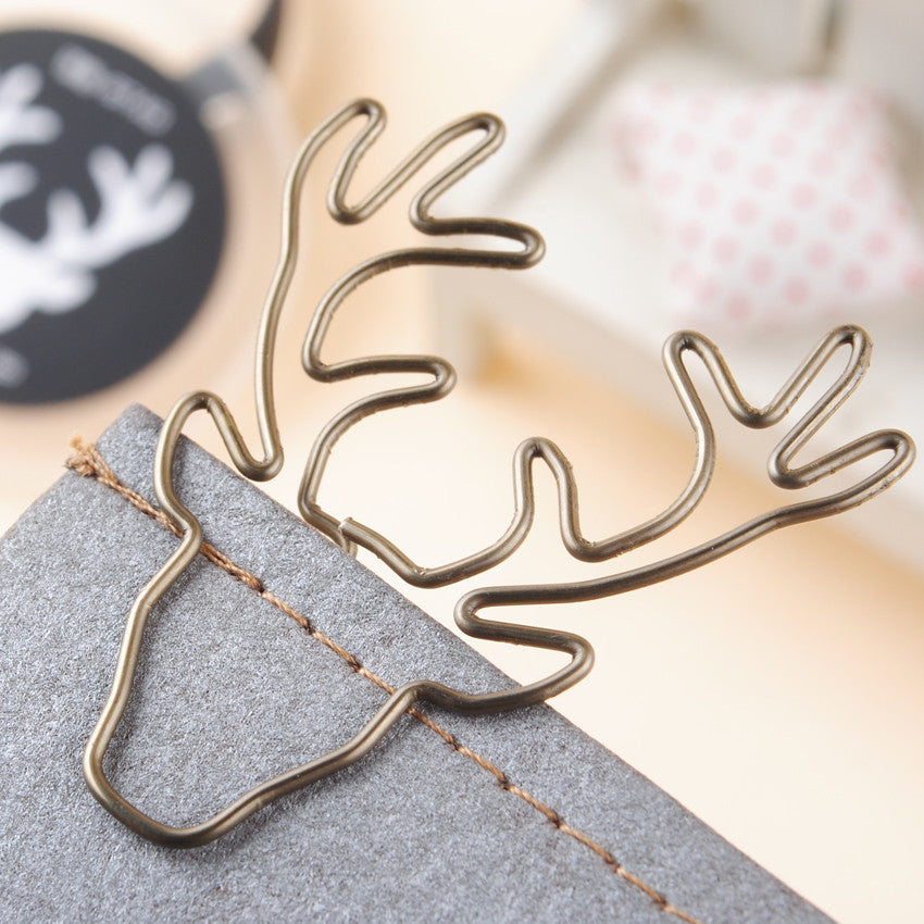 vintage deer shaped metal paper clips