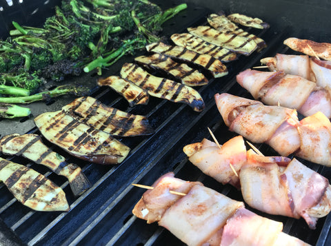 Bacon wrapped chicken tenders on the grill