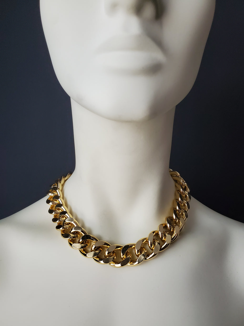 A must have for every Bad Girl! Our simple and sleek design, combined with our signature 18mm chain, makes this piece a timeless statement piece. The BADDIE CHOKER can be dressed up or down and looks great layered with other gold chain necklaces! -Gold color plating-Nickel-free chain link-Handmade in Cincinnati Every order is handmade direct from our production facility in Cincinnati, OH. Items are typically completed within 5-7 business days and then require additional shipping time to reach your location.