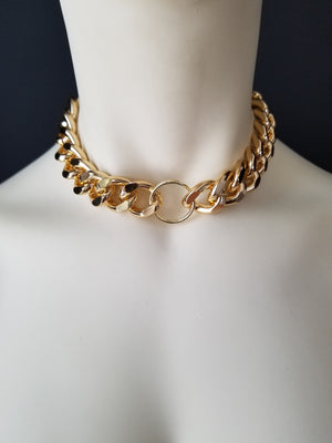 Our original O-RING CHOKER in gold! Stand out in this classic yet versatile chain. The o-ring detail gives it a touch of sexual taboo while still remaining ambiguous to onlookers. Make a statement with our O-RING CHOKER. -Gold color plating-Lead-free chain link-Handmade in Cincinnati.  Men and Women Jewelry FREEWHEELER / CINCINNATI / FASHION /
