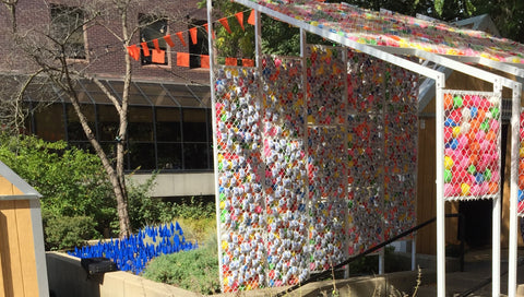 A new feature at this year's POP-X is this pavilion made from water balloons and emergency water rations. It asks visitors to think about the juxtaposition of water filling balloons for summertime fun versus water filling packs that are essential to life for some people in our world