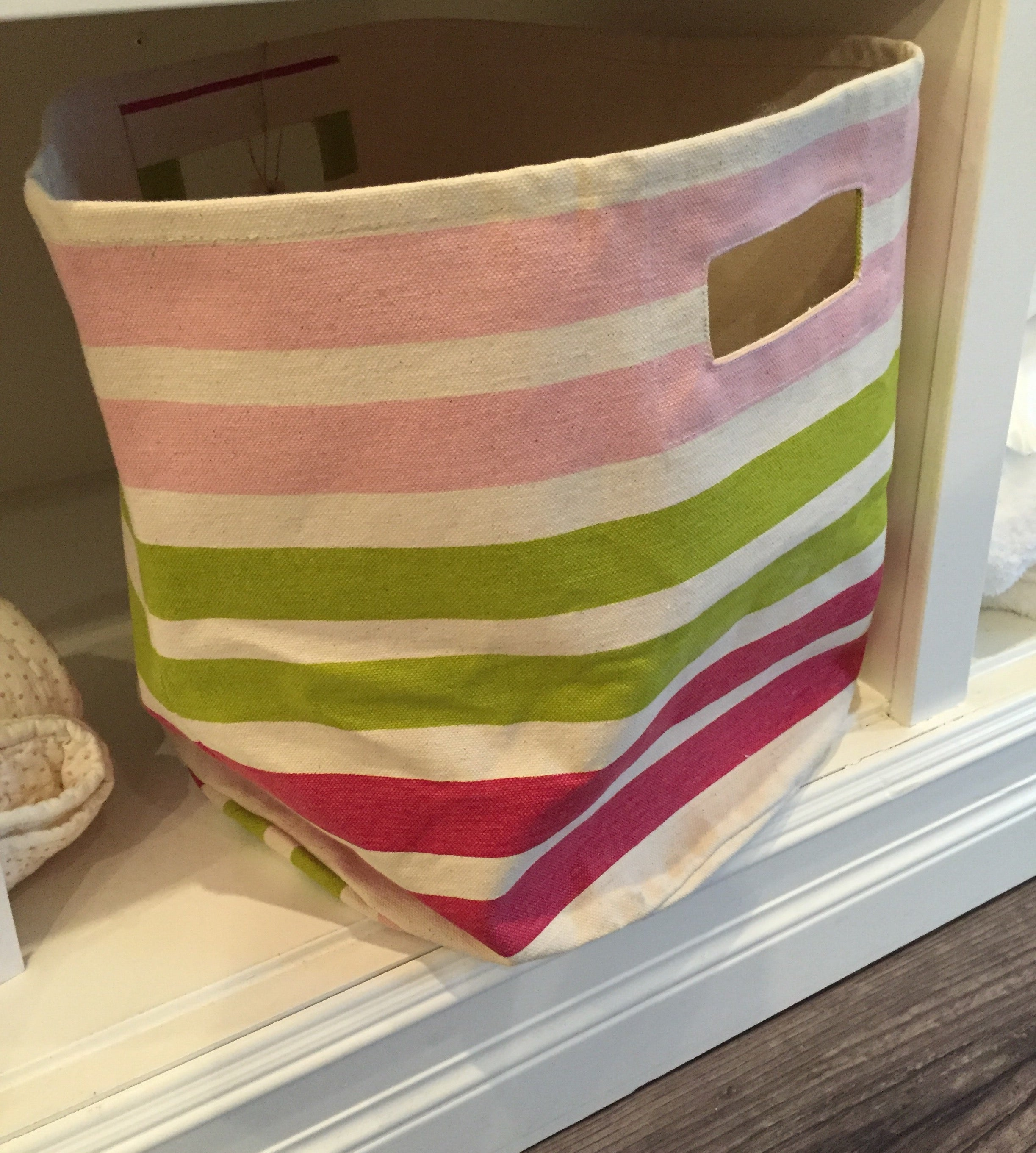 These Petit Pehr storage totes are functional and colorful - great for holding  toys, book, or blankets