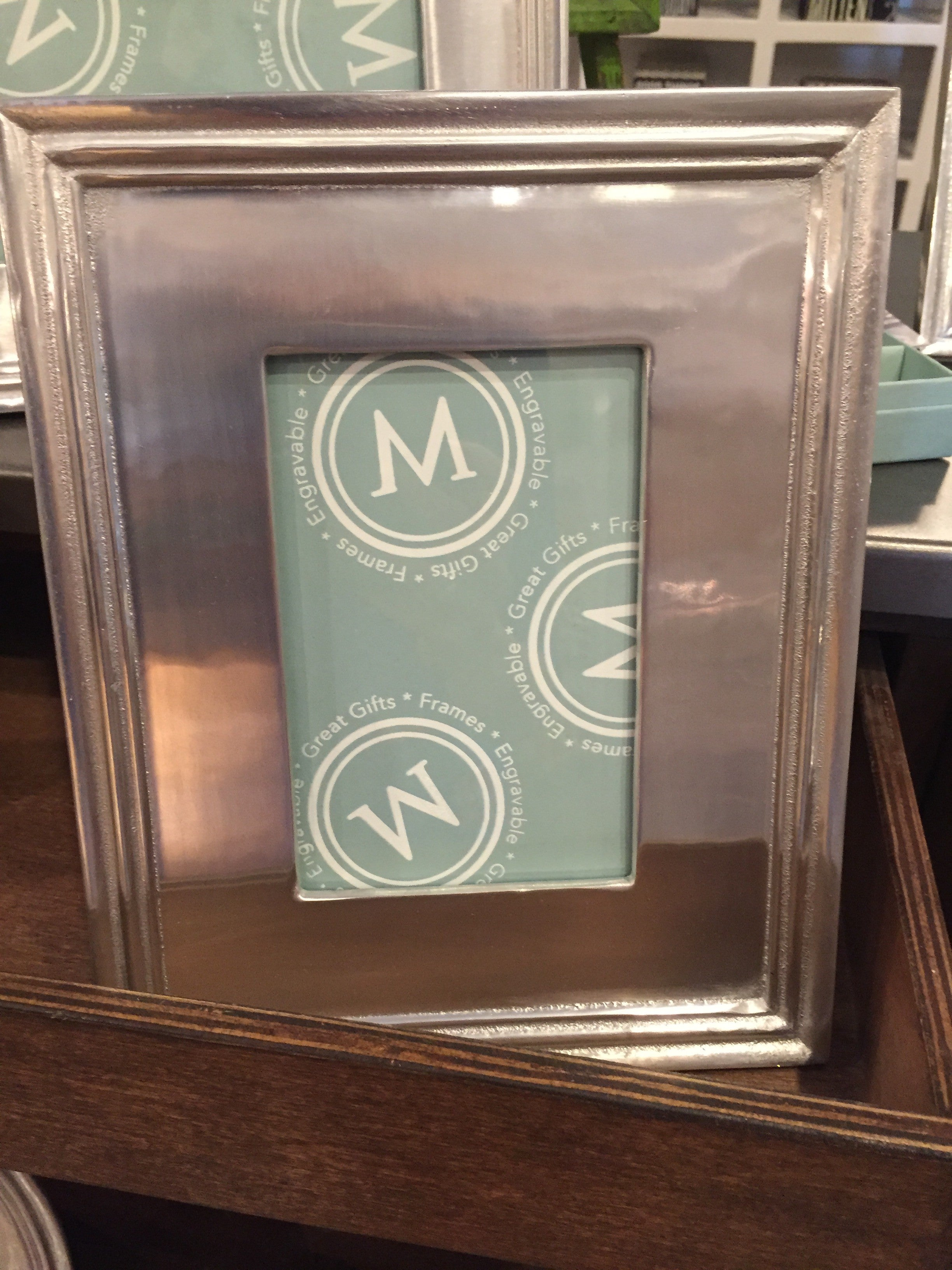 An engraved Mariposa frame is a great way for a grad to display their favorite picture from graduation day.