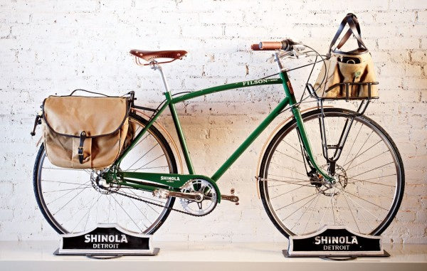 shinola bike and white wall and bags