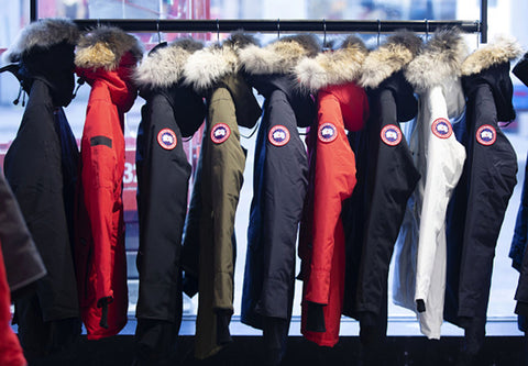 canada goose jackets lined on clothing rack
