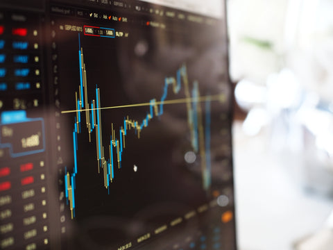 stock market charts on computer screen