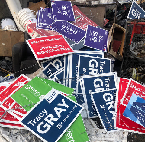 political lawn signs in the garbage Canadian federal election 2019