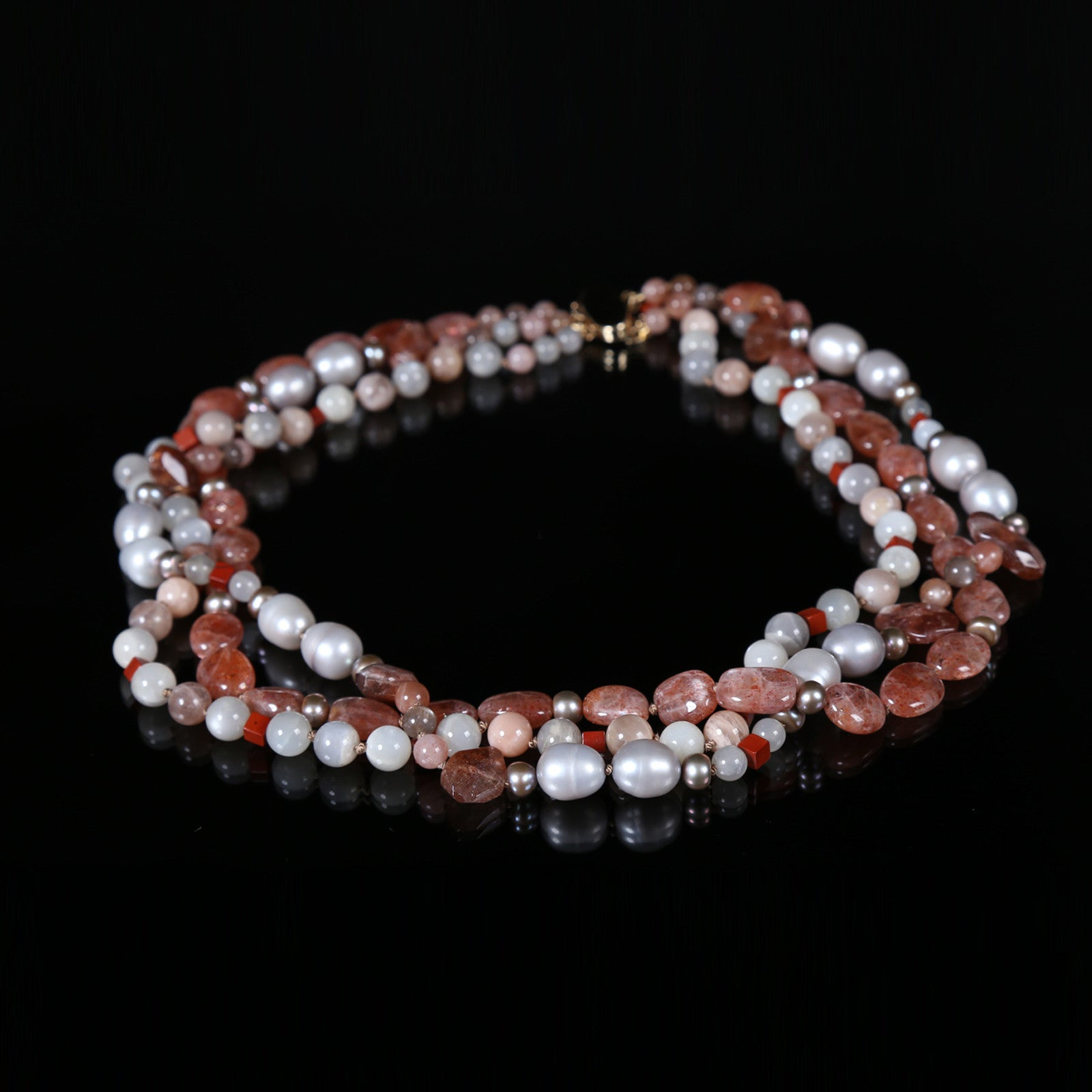 "White Orchid Studios | Made in the USA | Handcrafted couture jewelry inspired by nature. |  A three strand, torsade necklace of richly vibrant sunstone and glowing moonstone that alternate with jasper and freshwater button pearls. This necklace ends with a 14kt yellow gold clasp, 20.5"" $700"