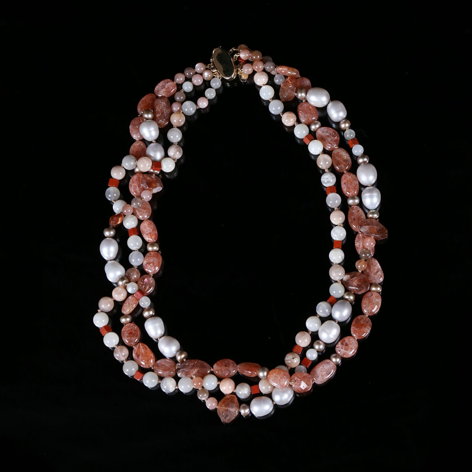 White Orchid Studios | Made in the USA | Handcrafted couture jewelry inspired by nature. |  A three strand, torsade necklace of richly vibrant sunstone and glowing moonstone that alternate with jasper and freshwater button pearls. This necklace ends with a 14kt yellow gold clasp, 20.5""
