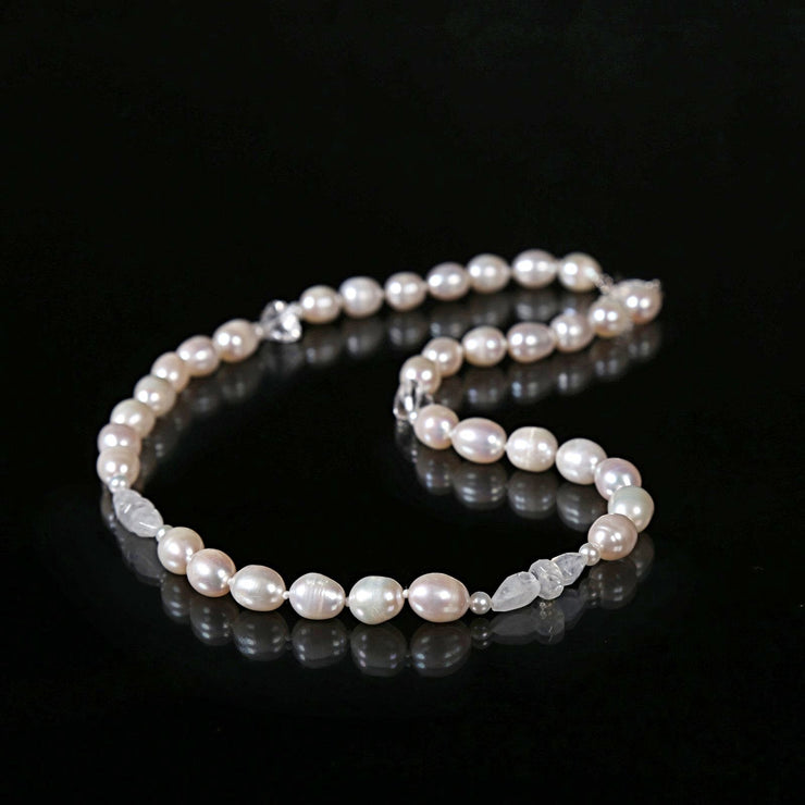 "White Orchid Studios | Made in the USA | Handcrafted couture jewelry inspired by nature. |  Soft white freshwater pearls combine with moonstone and clear quartz to evoke sweet awareness in a necklace ending with a 14kt white gold clasp, 18"" $375"
