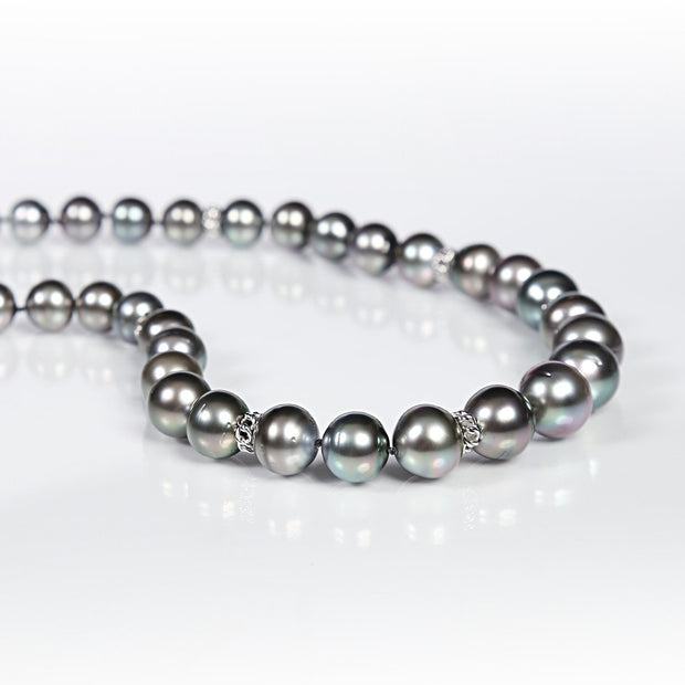 "White Orchid Studios | Made in the USA | Handcrafted couture jewelry inspired by nature. |  Black South Sea pearl necklace with 14kt white gold, open weave accents and a 14kt white gold fold-over clasp, 18.5"" $11,000"