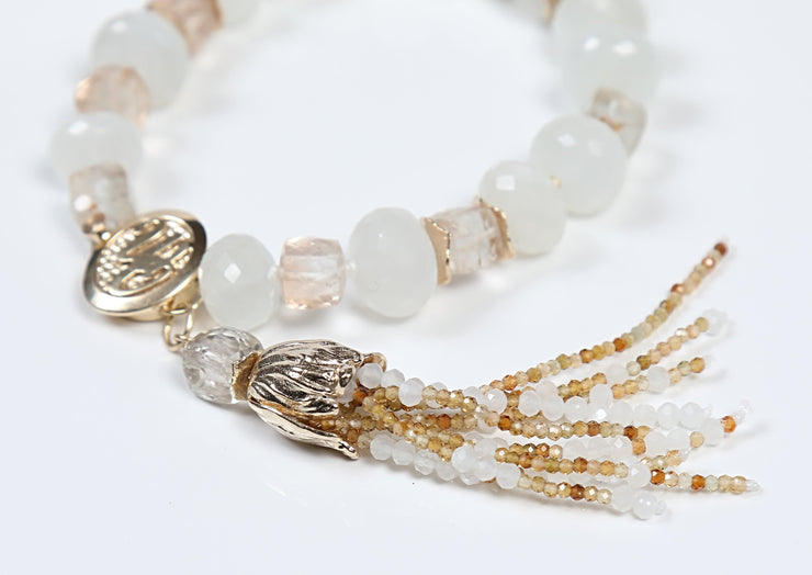 "White Orchid Studios | Made in the USA | Handcrafted couture jewelry inspired by nature. |  Faceted precious topaz and white moonstone accented by our custom 14kt yellow gold spacers, bead cap, and logo clasp, enhanced by a handcrafted moonstone and topaz tassel, 7.5"" $1288"
