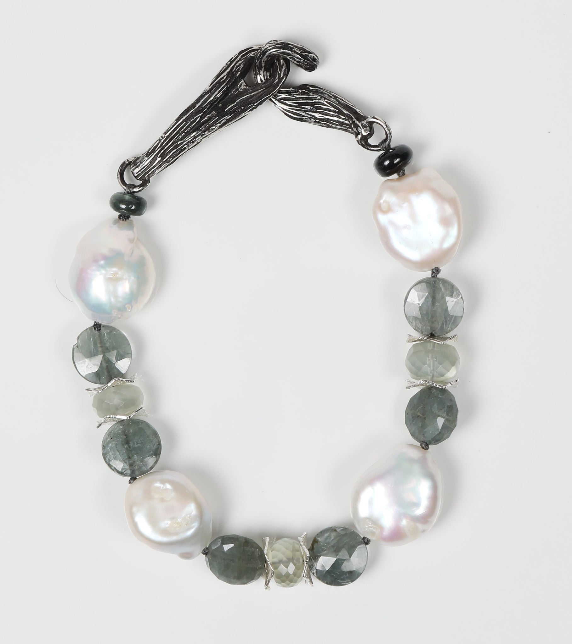 "White Orchid Studios | Made in the USA | Handcrafted couture jewelry inspired by nature. |  Beautiful freshwater pearls bounded by our hand-crafted sterling spacers, faceted moss aqua, and Ceylon moonstone.  Finished with our hand-carved, sterling vanilla bean clasp completes the bracelet, 9"" $482"