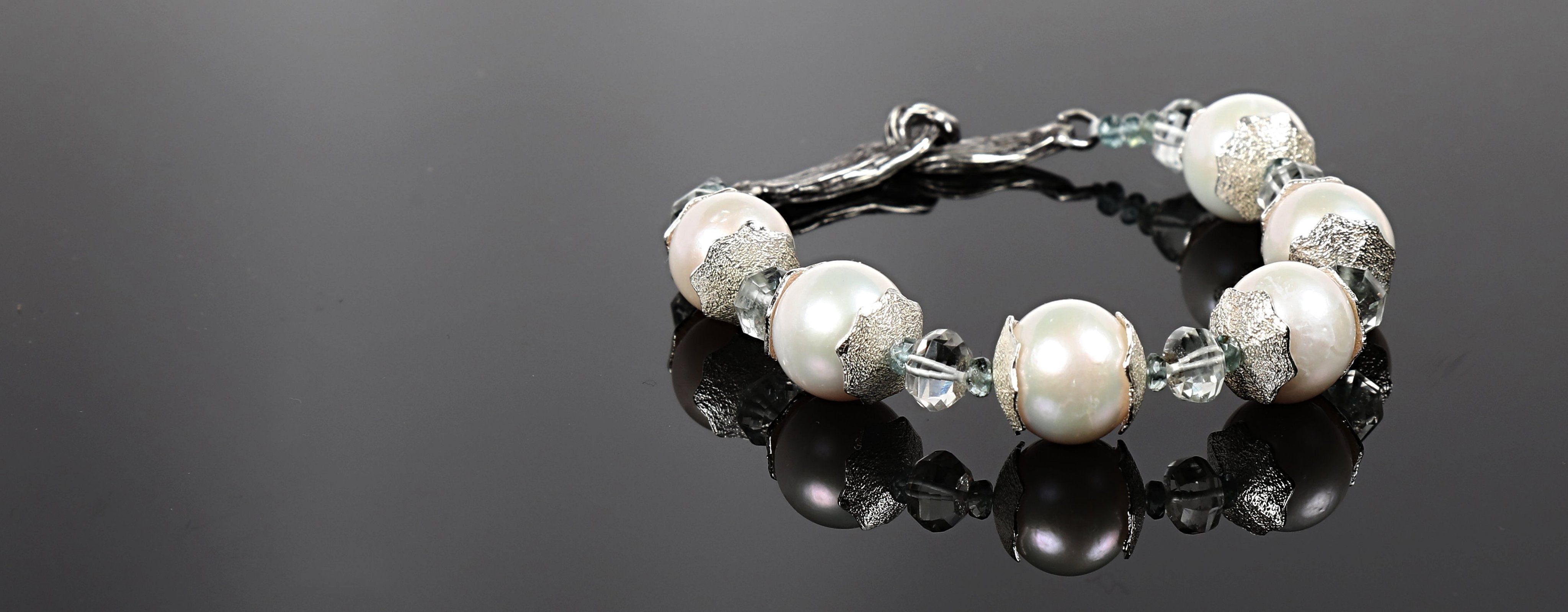 "White Orchid Studios | Made in the USA | Handcrafted couture jewelry inspired by nature. |  Beautiful freshwater pearls bounded by our hand-crafted sterling spacers, carved prasiolite and apatite, closed by our hand-carved vanilla bean clasp, 8.5"" $614"