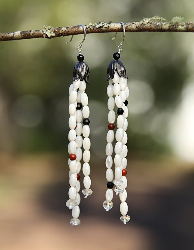 White Orchid Studios | Made in the USA | Handcrafted couture jewelry inspired by nature. |  A French-inspired design of rice-shaped mother of pearl, onyx, clear quartz and jasper topped by our hand-crafted sterling bead caps. $387