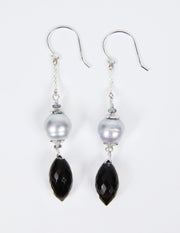 White Orchid Studios | Made in the USA | Handcrafted couture jewelry inspired by nature. |  Dramatic black spinel pairs with a silver pearl, our signature silver spacers and sterling earwires to affirm your soft power. $150