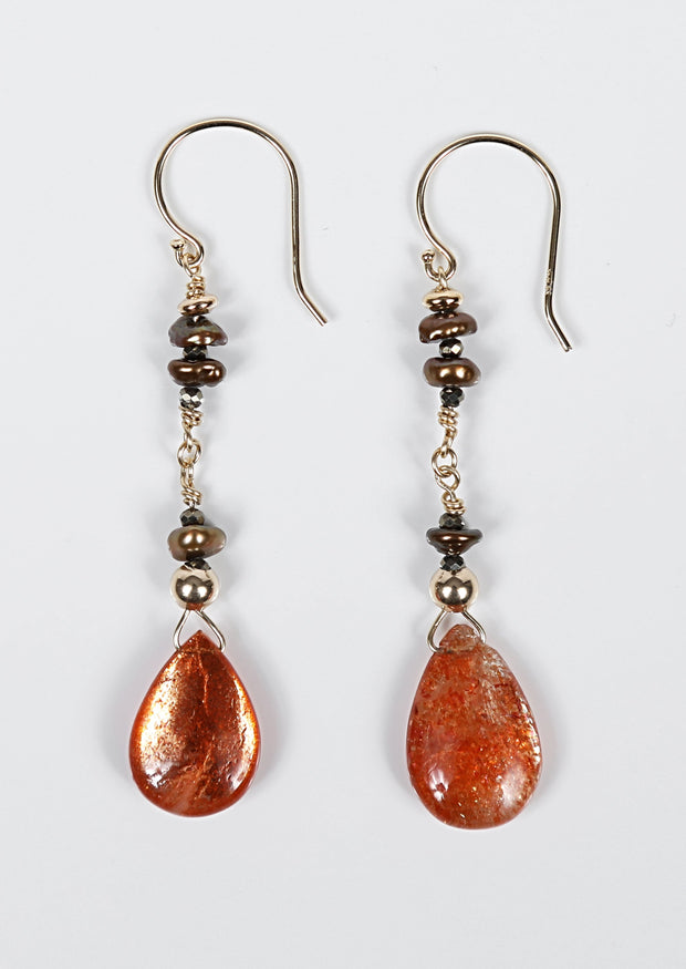 White Orchid Studios | Made in the USA | Handcrafted couture jewelry inspired by nature. |  Polished sunstone teardrops with Keshi pearls on 14kt yellow gold wire and earwires. $155