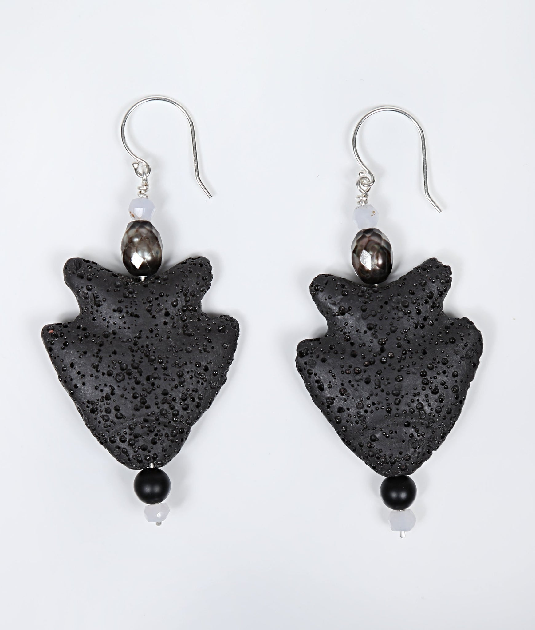 White Orchid Studios | Made in the USA | Handcrafted couture jewelry inspired by nature. |  Jumping fish earrings of carved black lava, light blue chalcedony, platinum freshwater pearls, and onyx on sterling earwires. $91
