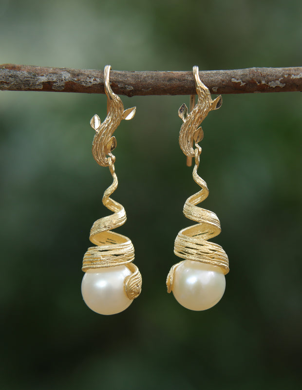 Golden Swirls: Drop Earring-Gold Leaves and a Ribbon Embrace a Freshwater Pearl.