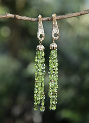 Harmony: Shoulder Duster Earrings-Gold Vanilla Beans Suspend Peridot Gold