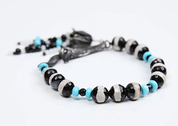 White Orchid Studios | Made in the USA | Handcrafted couture jewelry inspired by nature. | Sleeping Beauty turquoise is accented by banded agate and faceted black onyx.  The bracelet is brought together by our sterling vanilla bean clasp and a signature tassel. $757