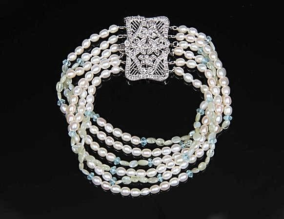 White Orchid Studios | Made in the USA | Handcrafted couture jewelry inspired by nature. |  A white gold and diamond clasp (.41ct) enjoys the company of 6 strands of freshwater pearls, faceted sky blue topaz and cat's eye chrysoberyl. $1350