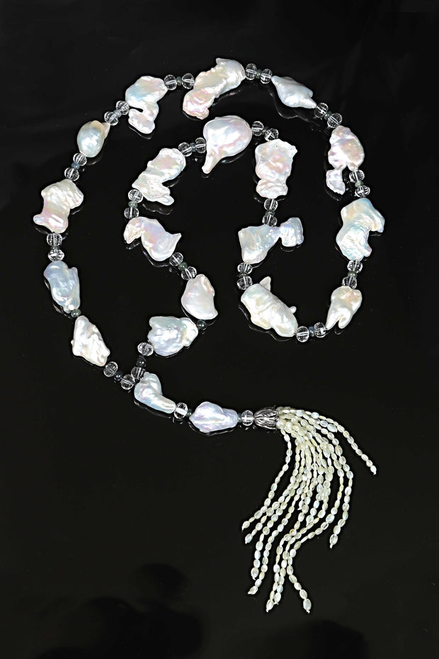 "White Orchid Studios | Made in the USA | Handcrafted couture jewelry inspired by nature. | A sartoir of beautiful, white freshwater Keshi pearls, faceted prasiolite, blue-green sapphires, and 13 strands of cat's eye chrysoberyl topped by one of our hand-crafted sterling bead caps. 45"" $1700"