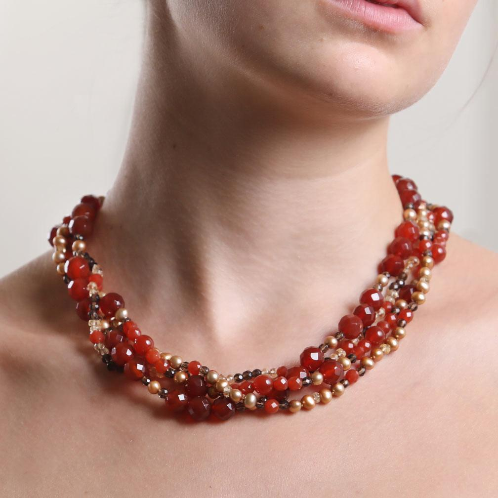 "White Orchid Studios | Made in the USA | Handcrafted couture jewelry inspired by nature. |  A three strand, torsade necklace features polished and faceted carnelian, smoky quartz, citrine and freshwater pearls The torsade ends in a 14kt yellow gold clasp, 19"" Contact us to inquire about a special order. $1250"