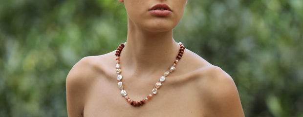 "White Orchid Studios | Made in the USA | Handcrafted couture jewelry inspired by nature. |  Keshi and button freshwater pearls weave in and out of sunstone and goldstone, all connected by faceted strawberry quartz. The necklace is finished with our 14kt yellow gold logo clasp. 20.5"" $696"