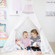 Kids having fun on their birthday party with their Cattywampus Blush Sky pink Teepee Tent