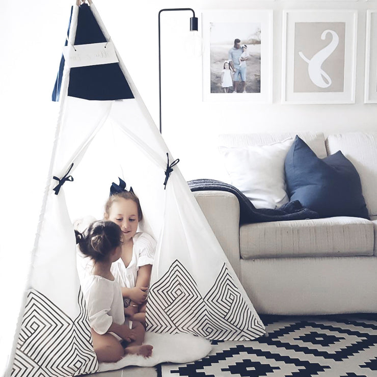 Kids playing and reading in their Cattywampus Gold Cloud Teepee tent on their birthday party