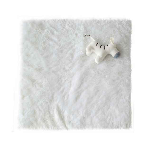 Cattywampus white fluffy faux fur playmat with grey cotton jersey