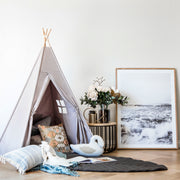 Cattywampus Wild Dove kids teepee tent in grey colour styled in home for a kids play space
