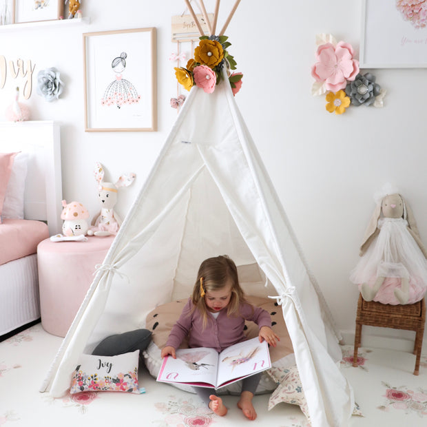 Little girl playing in her Cattywampus Snow Dust kids teepee tent