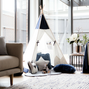 Cattywampus Gold Cloud kids teepee tent styled in the lounge room