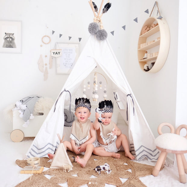 Kids playing in their Cattywampus Pearly Moon Teepee Tent in their bedroom