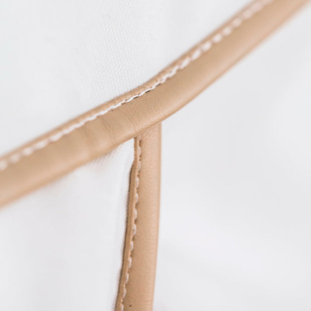 Close up of tan leatherette trim of Cattywampus Golden Star Teepee
