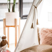 Close up of Cattywampus Golden Star Teepee with tan leather tassels interior design