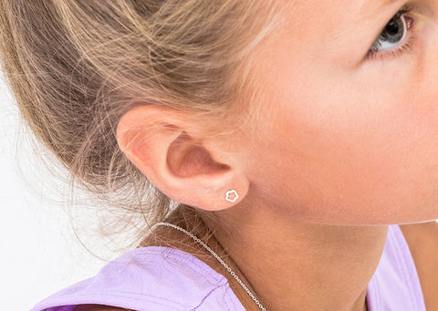young girl close up wearing sterling silver childrens earrings from Bo and Bala