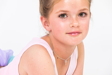 young girl wearing bo and bala wishing wand sterling silver necklace